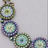 Will It Go Round In Circles Necklace in Green/Purple (close up)